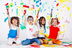 Friends painting. Four excited preschool friends painting Royalty Free Stock Photos