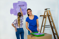 Friends painting a wall Royalty Free Stock Photo