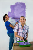 Friends painting a wall Royalty Free Stock Photos
