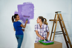 Friends painting a wall Stock Photos