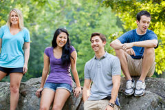 Friends at a park. Four friends in their early 20s hanging out at a park Royalty Free Stock Photos