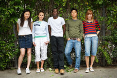 Friends in the park. A multicultural team proudly presents themselves as friends Royalty Free Stock Photography