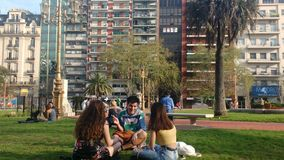 Friends in the park. Enjoyings the sun and the spring stock image