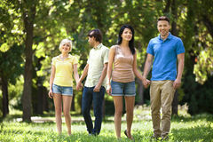 Friends in park. Royalty Free Stock Photo