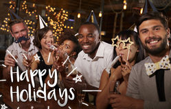Friends at a party in a bar with Happy Holidays message royalty free stock photo