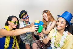 Friends are at a party. Celebrating the Brazilian Carnaval. Happ. Multi ethnic group of friends are making Carnaval party. Euphoria in Brazil. They are wearing Stock Photos