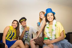 Friends are at a party. Celebrating the Brazilian Carnaval. Reve. Multi ethnic group of friends are making Carnaval party. Euphoria in Brazil. They are wearing Stock Photography
