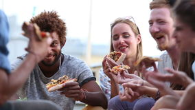 Friends at a party eating pizza stock video footage