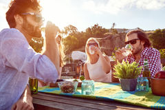 Friends party gathering on rooftop royalty free stock images