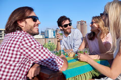 Friends party gathering on rooftop Stock Photos