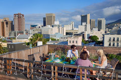 Friends party gathering on rooftop Stock Images