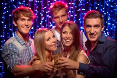 Friends at party in night club Royalty Free Stock Image