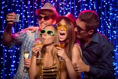 Friends at party in night club Stock Photo