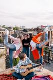 Friends party on roof. Happy leisure time Stock Images
