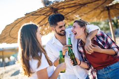 Friends partying and having fun on beach at summer. Happy friends partying and having fun on beach at summer royalty free stock photography