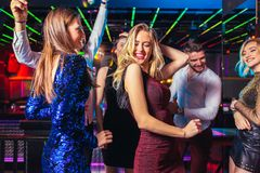 Friends partying in a nightclub. Group of friends partying in a nightclub stock image