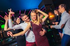 Friends partying in a nightclub. Group of friends partying in a nightclub royalty free stock image