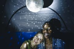 Friends partying in a tent together stock photography