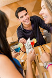 Friends paying for drinks at the bar Royalty Free Stock Photography