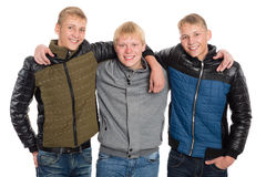 Friends peers in autumn jacket. Two of the boys twin brothers Stock Photos