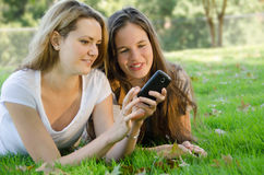 Friends with a Phone Royalty Free Stock Image