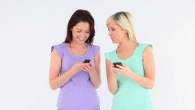 Friends with phones Royalty Free Stock Photos