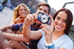 Friends with photo camera Royalty Free Stock Photography