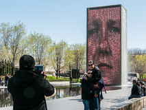 Friends photograph each other in front of Crown Fountain, Chicag Stock Photos