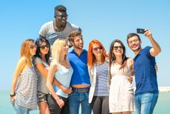 Friends photographing themselves. Group of friends taking a selfie royalty free stock photography