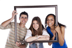 Friends picture. Three happy teenager friends inside a picture frame (isolated on white Royalty Free Stock Photo