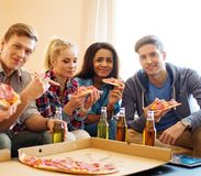 Friends with pizza and bottles of drink Royalty Free Stock Photos