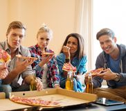 Friends with pizza and bottles of drink Royalty Free Stock Images