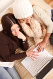 Friends planning winter holidays online Stock Image