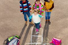 Friends play hopscotch Stock Photo