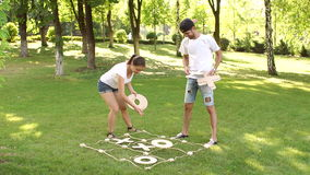 Friends play a large game of TIC TAC toe in Park. stock footage