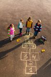 Friends play outside on hopscotch Stock Image