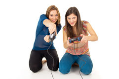 Friends play video games on the joysticks. Sisters play video games isolated Stock Images