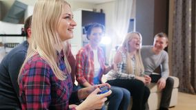 Friends play video games together. Group of friends playing Video Games stock video