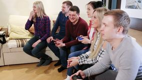 Group of friends playing Video Games. Friends play video games together stock video footage