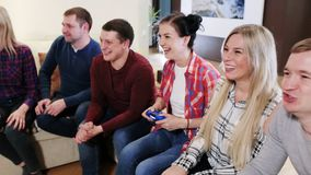 Friends play video games together. Happy group of male friends playing video games at home stock footage