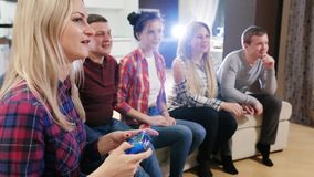 Happy group of male friends playing video games at home. Friends play video games together stock video