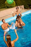 Friends playing ball in water laughing. Young friends playing ball in water, laughing, having fun at summertime Royalty Free Stock Photos