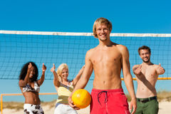 Friends playing Beach volleyball Stock Photos