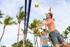 Friends playing beach volleyball sport in summer Royalty Free Stock Image