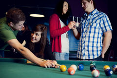 Friends playing billiard Royalty Free Stock Photo