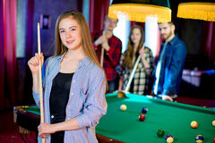 Friends playing billiard Stock Photo