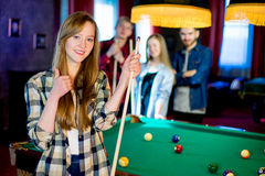 Friends playing billiard Royalty Free Stock Photos