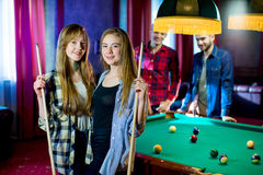 Friends playing billiard Stock Photography