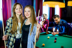 Friends playing billiard Stock Image