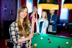 Friends playing billiard Stock Image